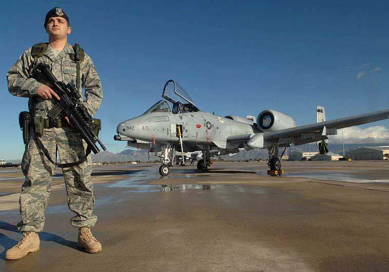 Air Force Airman with Fighter Jet in Background