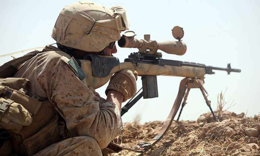 Marine Sniper with Long Range Scope in Afghanistan