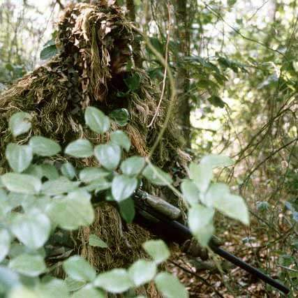 Marine Sniper Wearing a Ghillie Suit