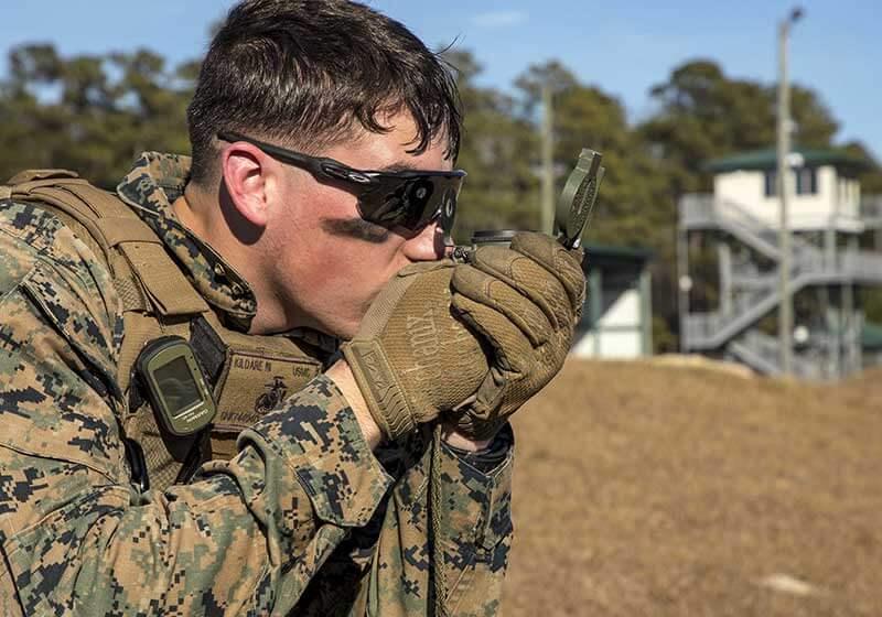 Marine Using a Lensatic Compass