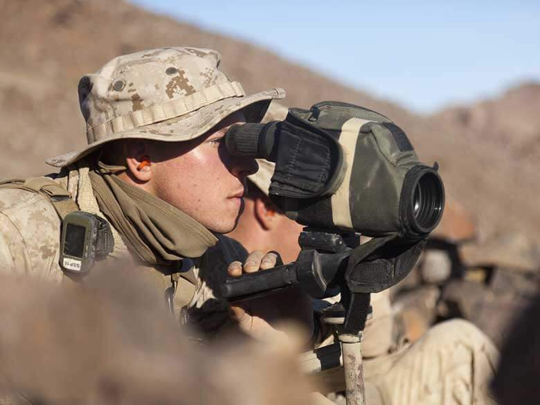 United States Marine looking through a spotting scope