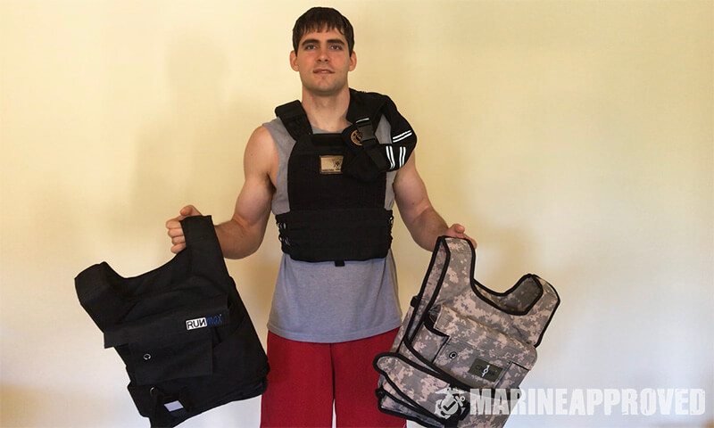 Marine Holding Several Weighted Vests