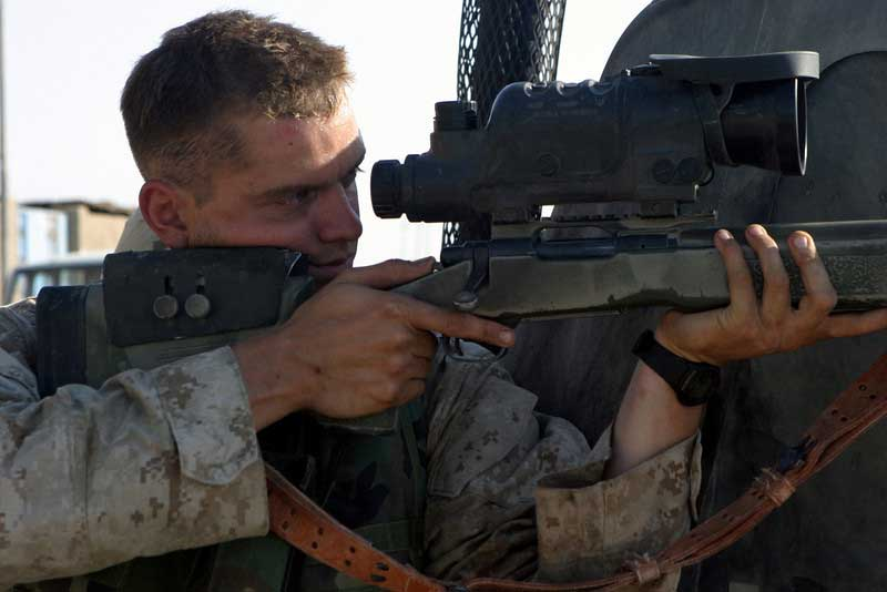 Marine Sniper Using a Night Vision Scope