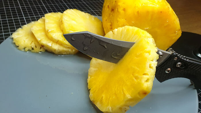 Reverse Tanto Blade Slicing a Pineapple